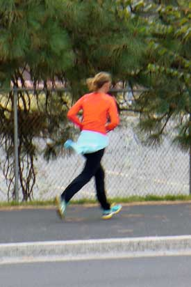 Runner in orange shirt